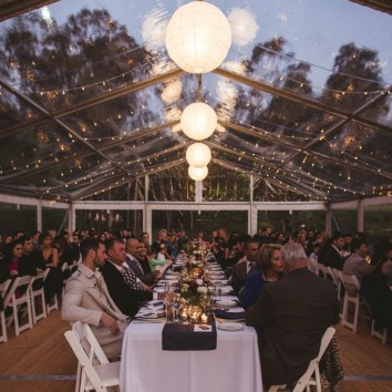Wedding table under clear marquee